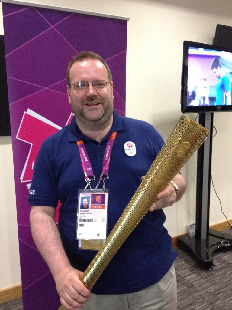 With the Olympic Torch during London 2012. August 2012.